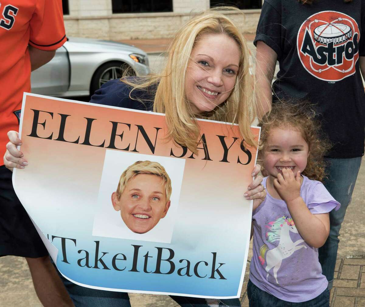 """Houston Astros fans line up for a chance to appear on """"The Ellen DeGeneres Show"""" in a segment being taped outside Minute Maid Park on Wednesday, May 22, 2019, in Houston."""