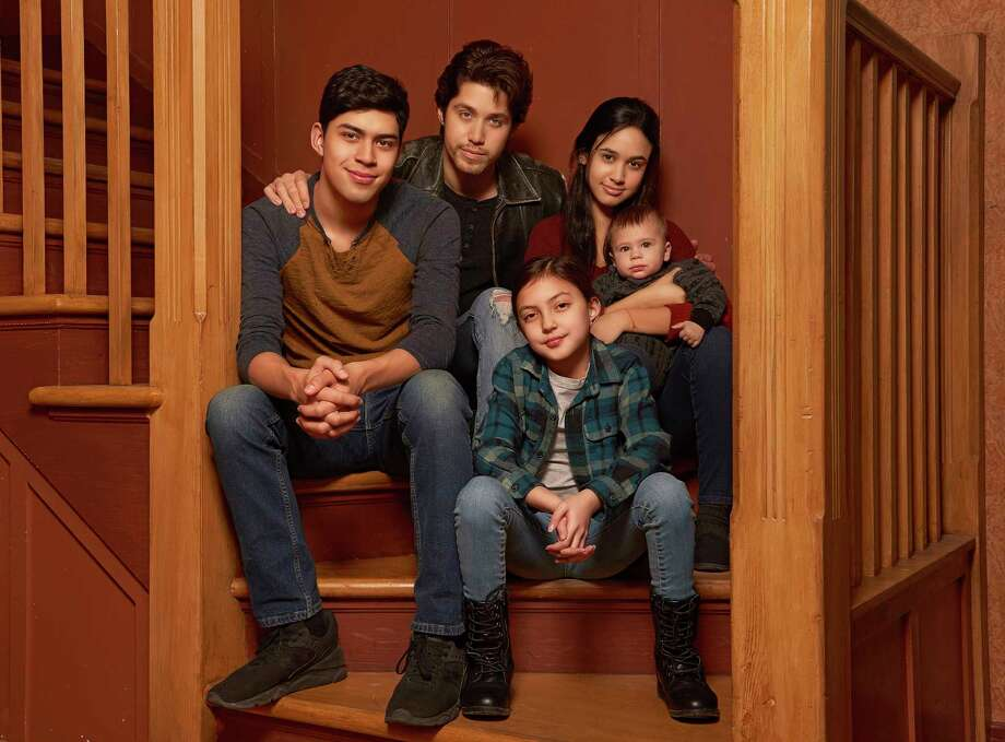 "This image released by Freeform shows the cast of ""Party of Five,"" Niko Guardado as Beto Buendia, left, Brandon Larracuente as Emilio Buendia, Elle Paris Legaspi as Valentina Buendia, foreground right, and Emily Tosta as Lucia Buendia. The reboot of the 1990s teen drama centers on a Mexican American family whose parents were deported to Mexico. (Vu Ong/Freeform via AP) Photo: Vu Ong / © 2019 Disney Enterprises, Inc. All rights reserved."