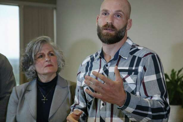 Michael Behenna, right, answers a question during a news conference May 8 in Oklahoma City. At left is his mother, Vicki Behenna. Behenna has been pardoned from his 2009 conviction for killing an Iraqi prisoner. A reader worries what message these pardons will impart.