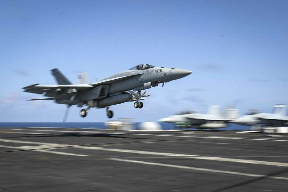 An F/A-18E Super Hornet from the Fist of the Fleet of Strike Fighter Squadron (VFA) 25 landing on the flight deck of the Nimitz-class aircraft carrier USS Abraham Lincoln (CVN 72) at the Gulf on Monday. Photo: MC3 JEFF SHERMAN /AFP /Getty Images / AFP