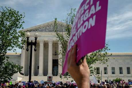 Abortion rights activists gather for a rally outside the Supreme Court in Washington on Tuesday, May 21, 2019. Similar rallies were planned for several cities across the country.