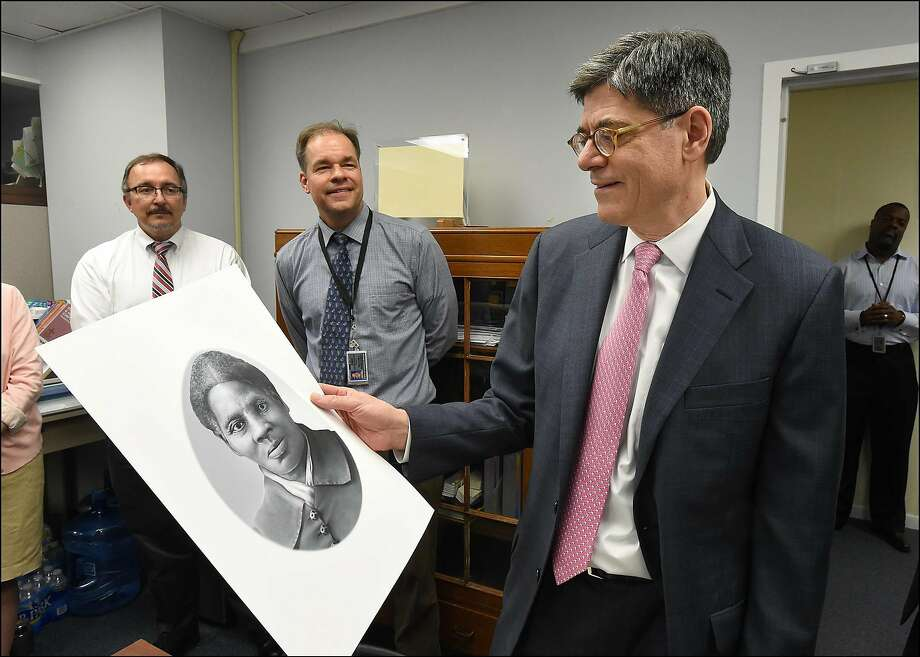 (FILES) In this US Department of Treasury handout file photo taken on April 20, 2016 shows Treasury Secretary Jacob Lew looking at a rendering of Harriet Tubman during a visit to the Bureau of Engraving and Printing in Washington, DC on April 21, 2016. - Plans to unveil a new $20 bill featuring anti-slavery activist Harriet Tubman have been postponed for almost a decade, US Treasury Secretary Steven Mnuchin said May 22, 2019. Tubman, who escaped slavery and helped others to freedom on the Underground Railroad, was due to appear on the bill starting next year, replacing slave-owning former President Andrew Jackson, whom President Donald Trump admires. (Photo by Chris Taylor / Department of Treasury / AFP) Photo: Chris Taylor, AFP/Getty Images