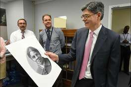 "(FILES) In this US Department of Treasury handout file photo taken on April 20, 2016 shows Treasury Secretary Jacob Lew looking at a rendering of Harriet Tubman during a visit to the Bureau of Engraving and Printing in Washington, DC on April 21, 2016. - Plans to unveil a new $20 bill featuring anti-slavery activist Harriet Tubman have been postponed for almost a decade, US Treasury Secretary Steven Mnuchin said May 22, 2019. Tubman, who escaped slavery and helped others to freedom on the Underground Railroad, was due to appear on the bill starting next year, replacing slave-owning former President Andrew Jackson, whom President Donald Trump admires. (Photo by Chris Taylor / Department of Treasury / AFP) / RESTRICTED TO EDITORIAL USE - MANDATORY CREDIT ""AFP PHOTO / HO/ US Department of Treasury/ Chris Taylor"" - NO MARKETING NO ADVERTISING CAMPAIGNS - DISTRIBUTED AS A SERVICE TO CLIENTSCHRIS TAYLOR/AFP/Getty Images"