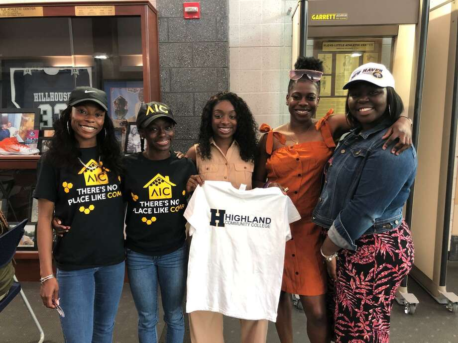 From left, Hillhouse girls track and field standouts Nyimah Ambrose, Jada Boyd, De'Janay Davis, Ayesha Nelson, and Jalynn McCown each made their collegiate choices known Wednesday at a signing ceremony at the Floyd Little Athletic Center. Photo: Will Aldam / Hearst Connecticut Media