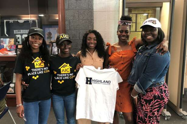 From left, Hillhouse girls track and field standouts Nyimah Ambrose, Jada Boyd, De'Janay Davis, Ayesha Nelson, and Jalynn McCown each made their collegiate choices known Wednesday at a signing ceremony at the Floyd Little Athletic Center.