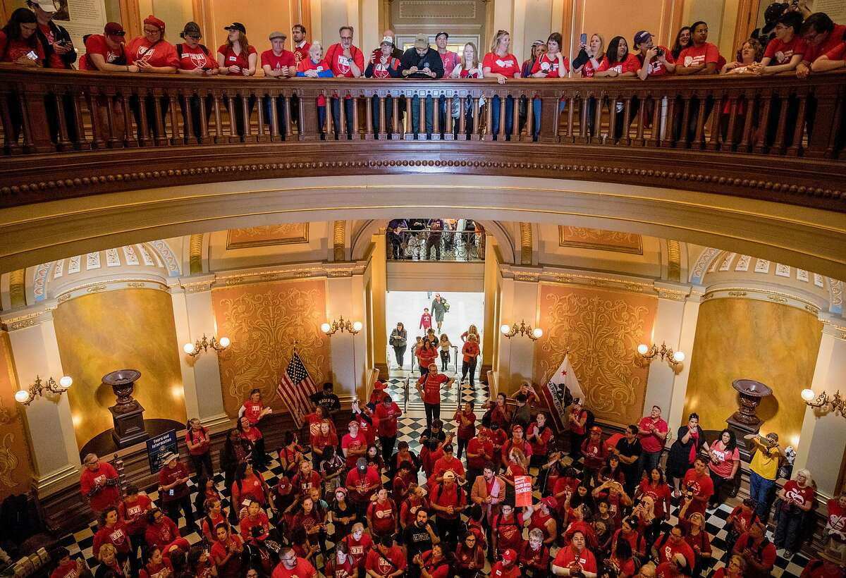 Thousands of public school teachers, administrators and supports gather in the rotunda of California's State Capitol during a march and rally held to urge state legislators to provide more funding for public schools in Sacramento, Calif. Wednesday, May 22, 2019.