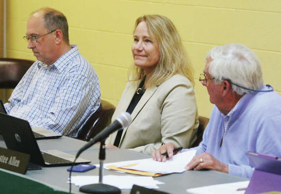 New Godfrey Village Board Trustee Virginia Woulfe-Beile watches the proceedings after being sworn in at Tuesday's Village Board meeting. Trustees Ben Allen and Karen McAtee were also reelected.