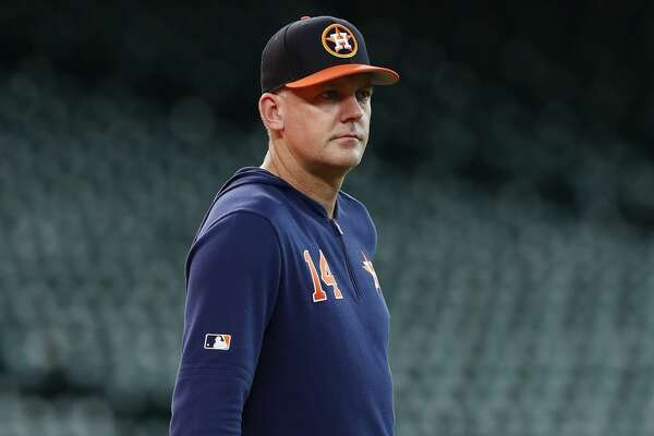 HOUSTON, TX - MAY 08: AJ Hinch #14 of the Houston Astros watches players warm up before the game against the Kansas City Royals at Minute Maid Park on May 8, 2019 in Houston, Texas. (Photo by Tim Warner/Getty Images)