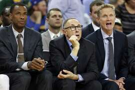 Golden State Warriors' coaching staff Jarron Collins, Ron Adams, Steve Kerr and Luke Walton during 121-85 over New York Knicks in NBA game at Oracle Arena in Oakland, Calif., on Wednesday, March 16, 2016.