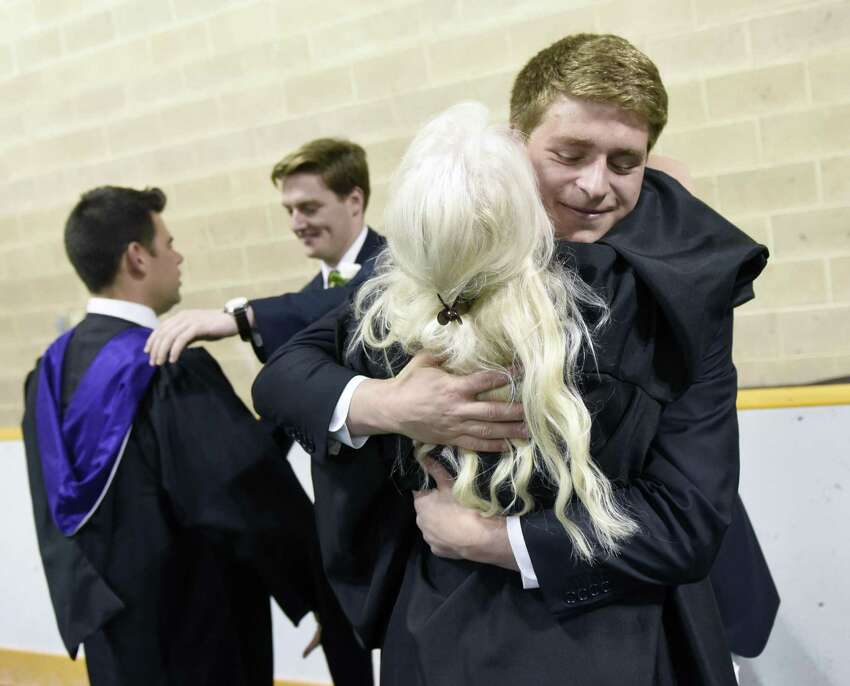 Keegan Drew, of Harrison, N.Y., hugs teacher Dawn Dawn Berrocal before the Brunswick School 117th Commencement. t Brunswick's School's Dann Gymnasium in Greenwich, Conn. Wednesday, May 22, 2019. Retired Supreme Court Associate Justice Anthony M. Kennedy gave the commencement speech before 100 new graduates walked across the stage.