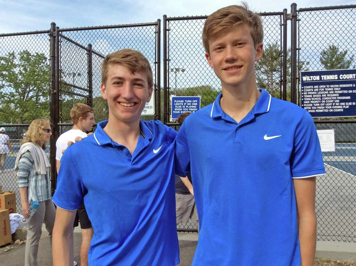 Darien doubles team Romano DeCaprio, left and Chris Calderwood were victorious in their match against Staples in the FCIAC boys championship tennis match at Wilton High School on Wednesday, May 22, 2019.
