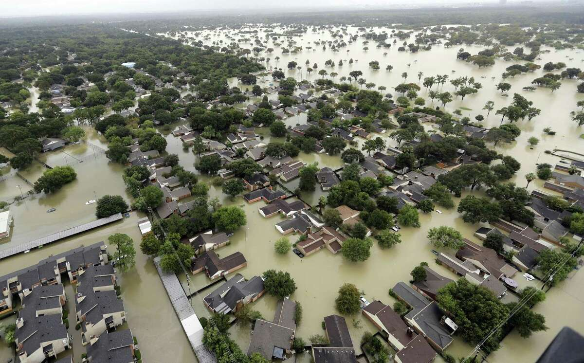 Water from Addicks Reservoir flows into neighborhoods from floodwaters brought on by Hurricane Harvey in Houston on Aug. 29, 2017. (AP Photo/David J. Phillip)
