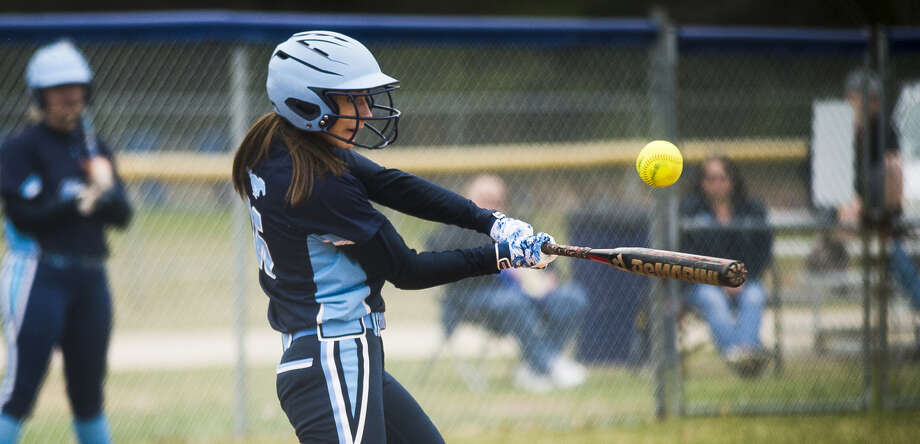Meridian's Mya Hall takes a big rip during an April 24, 2018 game against Dow High. Photo: Daily News File Photo