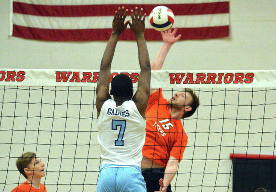 Edwardsville's Daniel Pauk, right, goes up for a kill during Wednesday's match against Belleville East in the finals of the Granite City Regional. Photo: Scott Marion/The Intelligencer