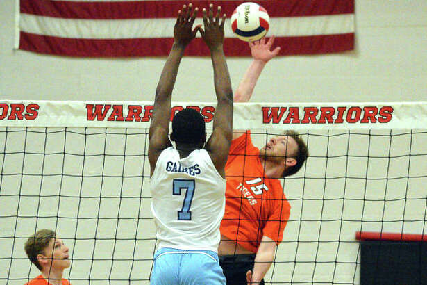 Edwardsville's Daniel Pauk, right, goes up for a kill during Wednesday's match against Belleville East in the finals of the Granite City Regional.