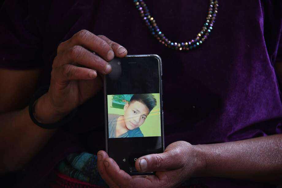 Rigoberta Vasquez holds a photo of her sixteen-year-old son, Carlos Hernandez Vasquez, who died in a U.S. Border Patrol holding cell in Texas. Photo: Johan Ordonez / AFP / Getty Images