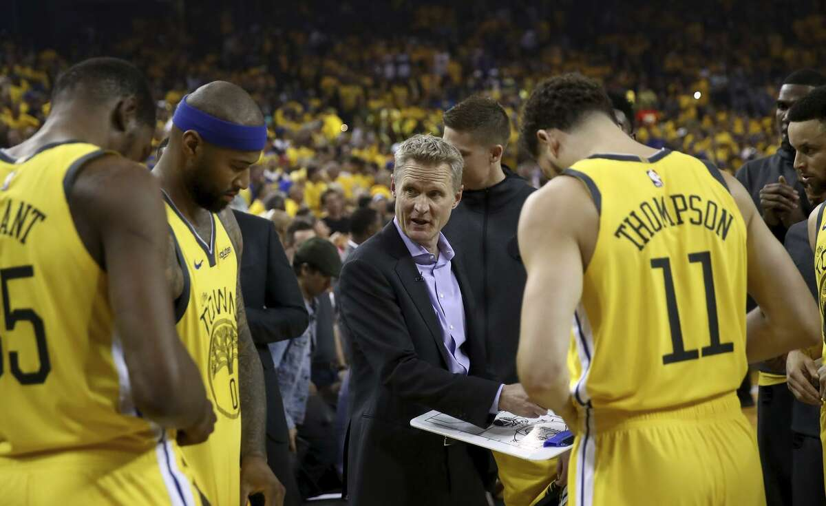 Top: Head coach Steve Kerr of the Golden State Warriors talks to their team before their game against the LA Clippers during Game Two of the first round of the 2019 NBA Western Conference Playoffs at ORACLE Arena on April 15, 2019 in Oakland, California. NOTE TO USER: User expressly acknowledges and agrees that, by downloading and or using this photograph, User is consenting to the terms and conditions of the Getty Images License Agreement. (Photo by Ezra Shaw/Getty Images)