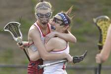 New Fairfield teammates Reagan Tenaglia (23), right, and Nicole Berry (5) celebrate Tenaglia's winning goal in the SWC final against Pomperaug on Wednesday.