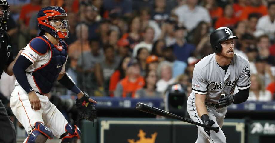Chicago White Sox Charlie Tilson and Houston Astros catcher Robinson Chirinos (28) watch the flight of Tilson's grand slam home run off Houston Astros reliever Josh James during the sixth inning of a major league baseball game at Minute Maid Park on Wednesday, May 22, 2019, in Houston. Photo: Brett Coomer/Staff Photographer