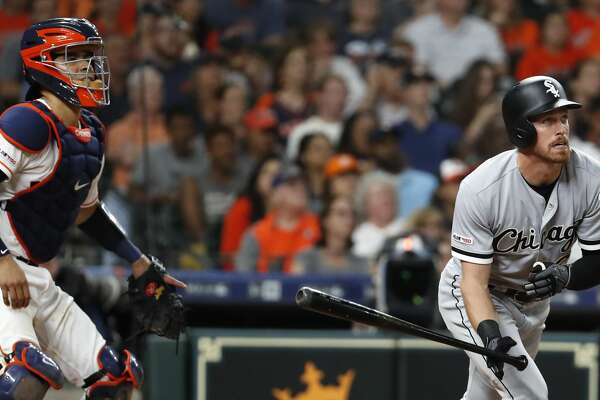 Chicago White Sox Charlie Tilson and Houston Astros catcher Robinson Chirinos (28) watch the flight of Tilson's grand slam home run off Houston Astros reliever Josh James during the sixth inning of a major league baseball game at Minute Maid Park on Wednesday, May 22, 2019, in Houston.