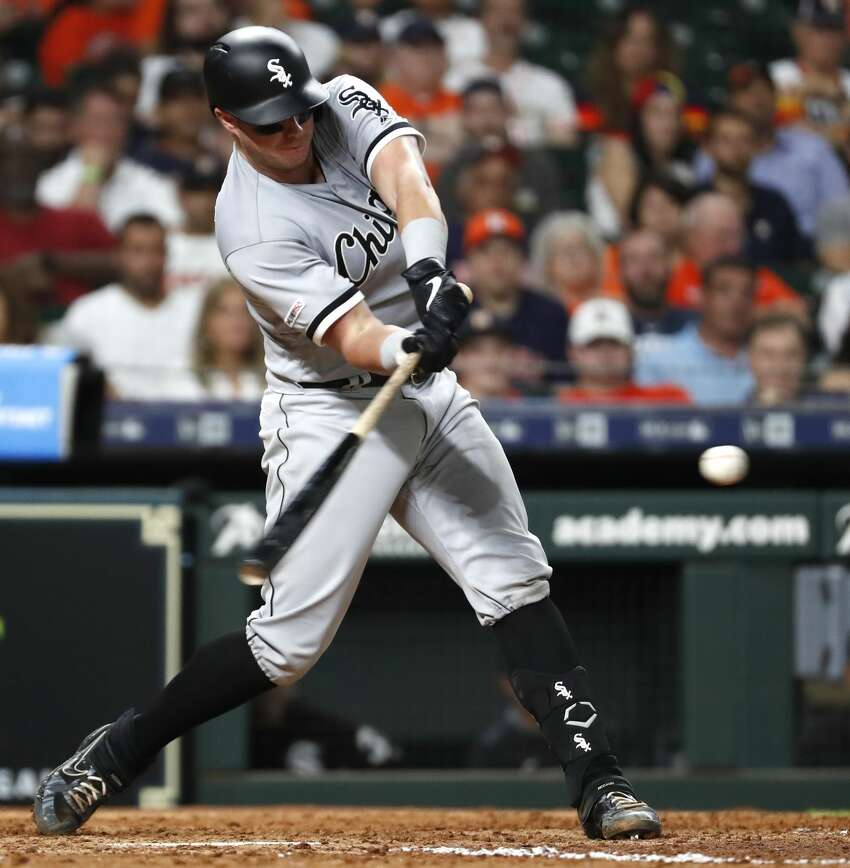 Chicago White Sox catcher James McCann hits an RBI double off Houston Astros starting pitcher Gerrit Cole during the sixth inning of a major league baseball game at Minute Maid Park on Wednesday, May 22, 2019, in Houston.
