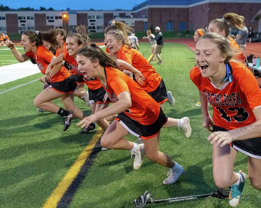 The Bethlehem girls lacrosse bench storms the field after beating Shenendehowa for the Section II, Class A championship at Mohonasen High School on Wednesday, May 22 2019 (Jim Franco/Special to the Times Union)