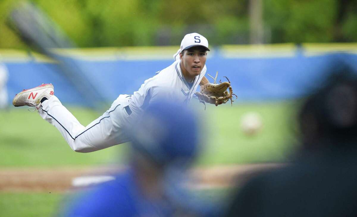 Staples Chad Knight (27) throws in the first inning against Fairfield Ludlowe in an FCIAC boys baseball championship at Cubeta Stadium on Wednesday, May 22, 2019 in Stamford, Connecticut.