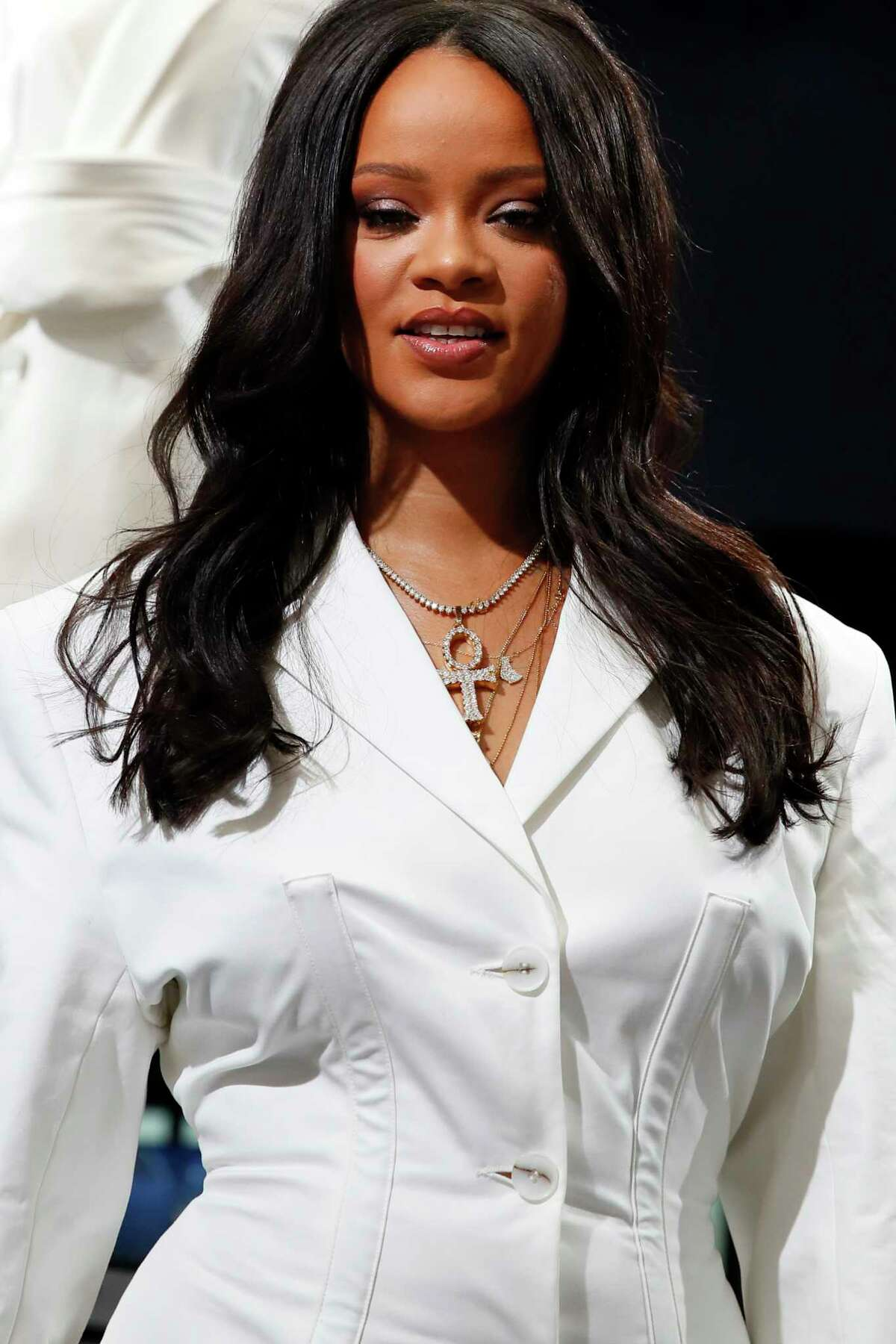 Rihanna poses as she unveils her first fashion designs for Fenty at a pop-up store in Paris, France, Wednesday, May 22, 2019. Singer Rihanna is the first black woman in history to head up a major Parisian luxury house, and the collection, named after the singer turned designer's last name, comprises of ready-to-wear, footwear, accessories, and eyewear and is available for sale Paris' Le Marais area from Friday and will debut online May 29.