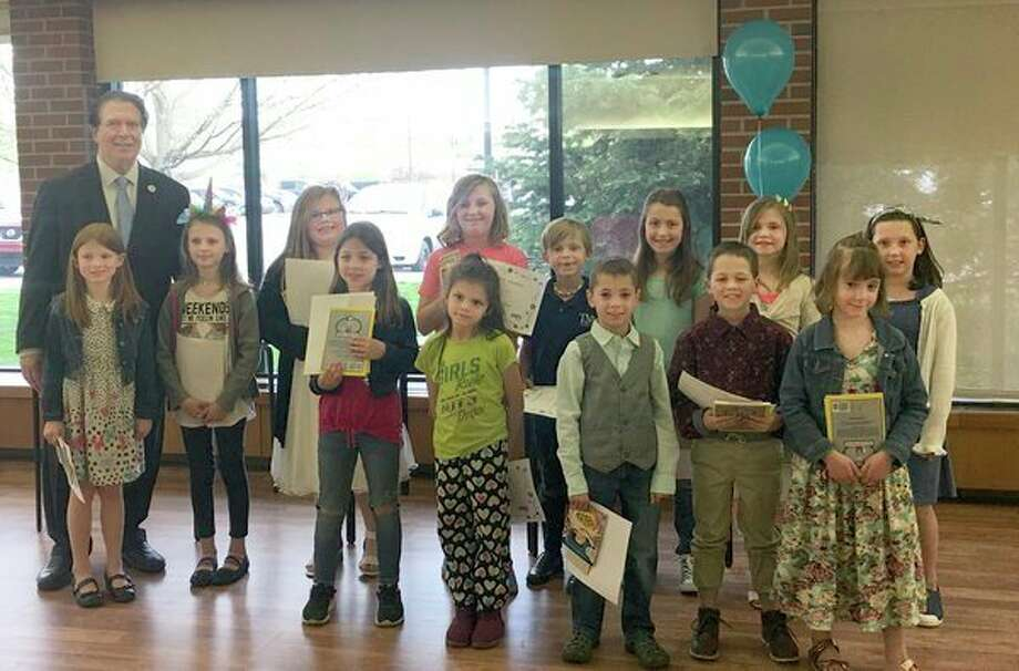 Second-grade students who demonstrated significant improvement in their reading skills over the course of the school year receive Claire's Award for Reading Excellence from the Rotary Club of Midland-Morning. (Photo provided)