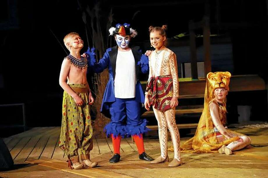 "Cast members Jake Schwartz (from left) as young Simba, Kaydence Daley as ZaZu, Adelyn Rollins as young Nala and Kristin Dennison as a lioness, rehearse a scene from Theatre in the Park's take on Disney's ""The Lion King Jr."" The play's run at the theater at Lincoln's New Salem State Historic Site in Petersburg continues this weekend with performances at 8 p.m. today, Friday and Saturday. A free preshow will begin at 7 p.m. nightly. Tickets, which are $15 for adults, $13 for seniors and $10 for children under 12, are available online at theatreinthepark.net or by calling 217-632-5440. Photo: Photo Provided"