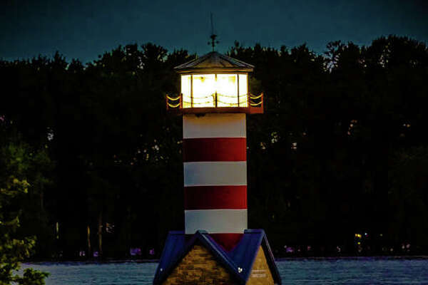 The Grafton lighthouse sends a reflection off the surface of floodwaters Wednesday night. While the National Weather Service, as of early Thursday morning, predicted a high crest of 31.1 feet to occur Sunday, which would be the fifth highest on record. However, Grafton Mayor Rick Eberlin said Wednesday that he's met with experts predicting 34 or 35 feet. That would mark the second highest on record. In 1993, levels reached 38.17 feet. The level was at about 28 feet when this photo was taken.