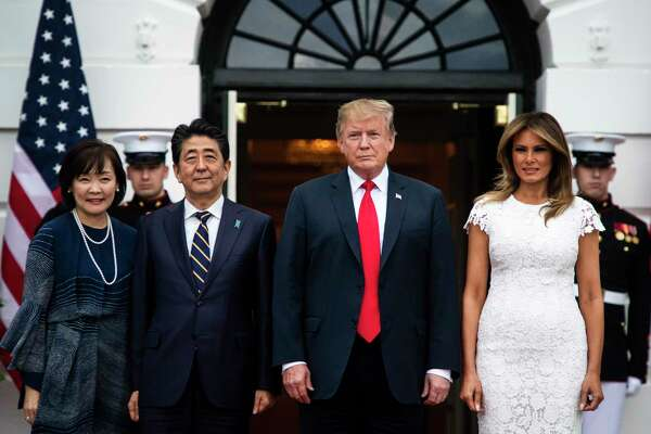 President Trump and first lady Melania Trump welcome Prime Minister of Japan Shinzo Abe and his wife Akie Abe outside the South Portico at the White House in Washington on April 26, 2019.