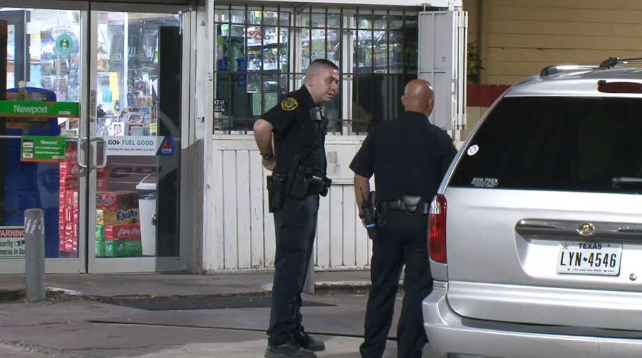 Police investigate a shooting early Thursday, May 23, during a robbery at a south Houston gas station. A clerk was shot in the incident, police said. Photo: Metro Video