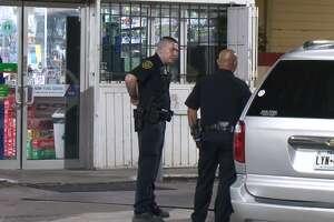 Police investigate a shooting early Thursday, May 23, during a robbery at a south Houston gas station. A clerk was shot in the incident, police said.