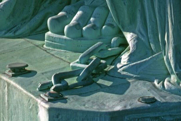 A close-up of part of the chains at the Statue of Liberty's feet.