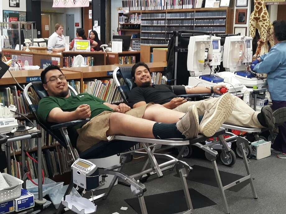 Luis Gonzales (on the left) and Rocky Rosas (on the right) give blood during the biannual Vitalant Blood Systems drive at the Unger Memorial Library on Tuesday. Photo: Kaelene Hansen/For The Herald