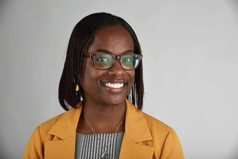 Carmeisha Huckleby, assistant director of Education Abroad at University at Albany, is pictured in the Times Union photo studio on Monday, April 15, 2019, in Colonie, N.Y. (Will Waldron/Times Union)