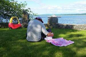The author with his young daughter in Begg's Park in Essex as the Vermont ferry passes by. (Chris Churchill photo)
