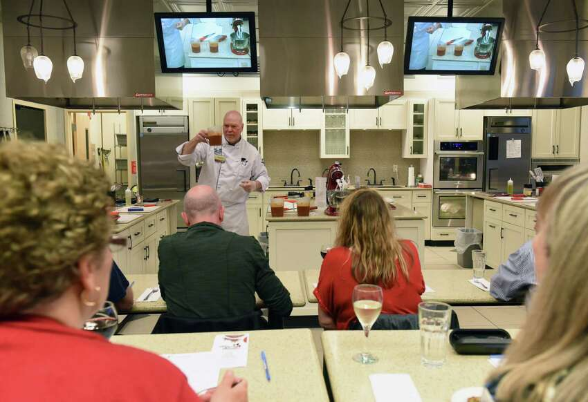 Chef Donald Graham teaches people how to prepare a recipe in a cooking class at Market Bistro on Thursday, April 18, 2019 in Latham, N.Y. The theme of the cooking class is Utica foods. (Lori Van Buren/Times Union)