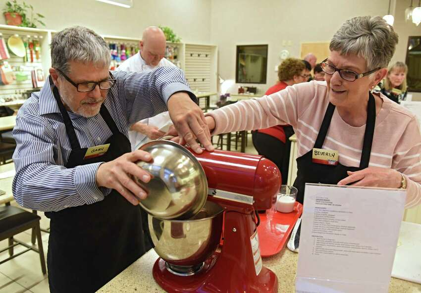 Gary Hahn of the Times Union and Beverly Milazzo of Queensbury work together on a Hemstroght's half-moon cookie recipe during a cooking class at Market Bistro on Thursday, April 18, 2019 in Latham, N.Y. The theme of the cooking class is Utica foods. (Lori Van Buren/Times Union)