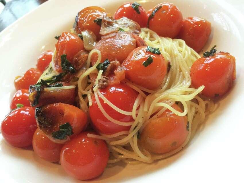 Capellini alla checca at Chianti il Ristorante in Saratoga Springs features thin pasta with a sauce based on raw tomatoes.