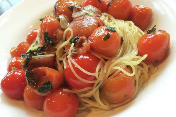 Capellini alla checca at Chianti il Ristorante in Saratoga Springs features thin pasta with a sauce based on raw tomatoes.