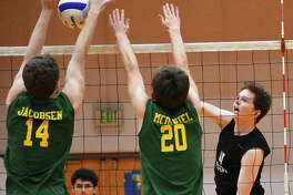 Edwardsville's Max Sellers, right, goes up for a kill during a regular season game against Metro-East Lutheran inside Lucco-Jackson Gymnasium.