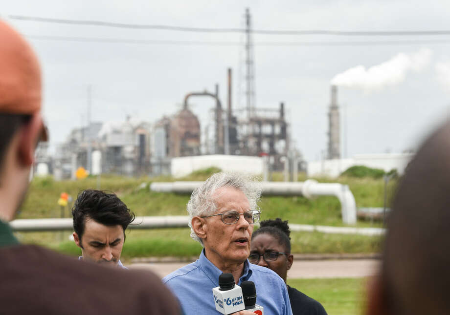 Clean Air Program Director for Sierra Club Neil Carman talks to members of the media and the community outside of Valero Energy's Port Arthur Refinery Wednesday as environmental groups announced their intent to sue the San Antonio refiner. Photo: Ryan Welch/The Enterprise