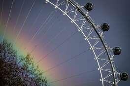A rainbow appears in the sky near the London Eye ferris wheel, operated by Merlin Entertainments, in London in March.