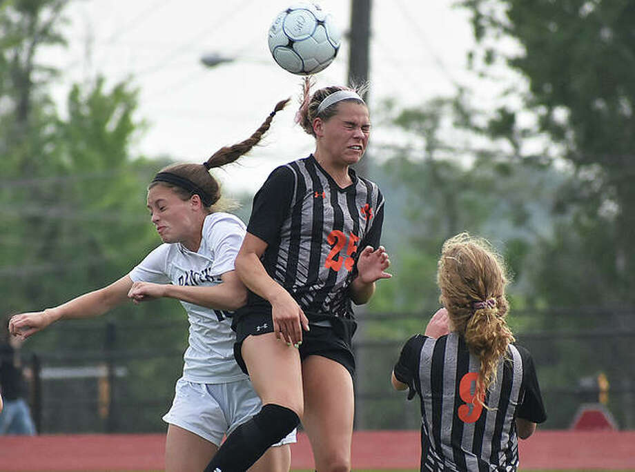 Edwardsville's Hannah Bielicke goes up for a header on a 50-50 ball at midfield during the first half of Tuesday's game against O'Fallon in the Class 3A Moline Sectional semifinals in Collinsville. Photo: Matt Kamp/The Intelligencer