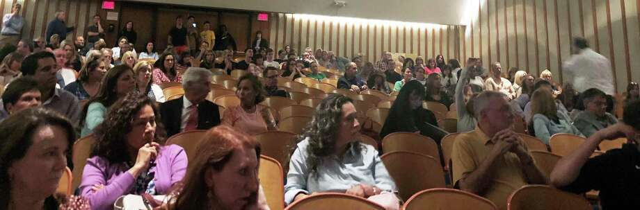 The Trinity Catholic High School auditorium was packed on May 22 for a community-wide meeting about the future of the school. Photo: Sophie Vaughan / Hearst Connecticut Media / Westport News