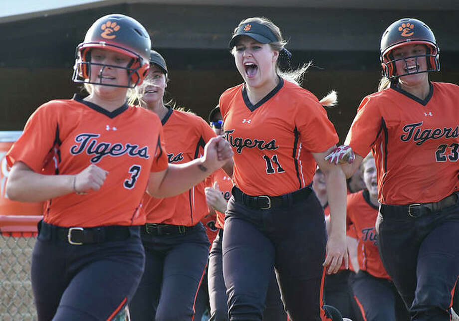 Edwardsville's Ellie Viox scores on Katherine Bobinski-Boyd's walk-off homer as teammates rush out of the dugout to celebrate. Photo: Matt Kamp/The Intelligencer