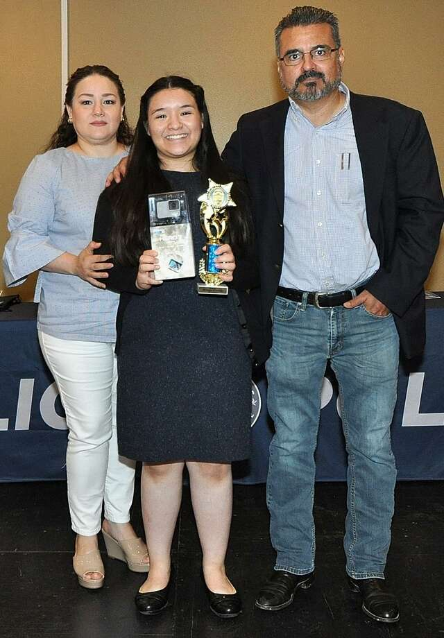 Outstanding 8th Grader of the Year first-place winner Valentina Moreno-Cruz from United Middle School is pictured alongside her parents Blanca Cruz De Moreno and Jorge Moreno. Photo: Courtesy Photo