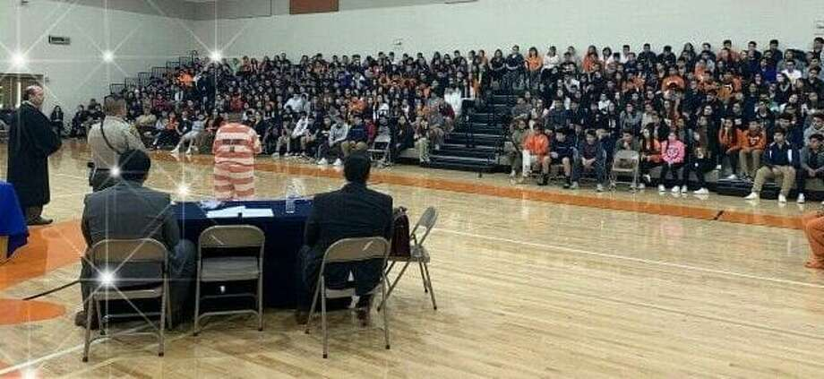 A defendant speaks to students on Friday during a Courts in School session at the United 9th Grade campus. 406th District Judge Oscar J. Hale Jr. held his sentencing hearings before 500 students. Photo: Courtesy Photo / 406th District Court